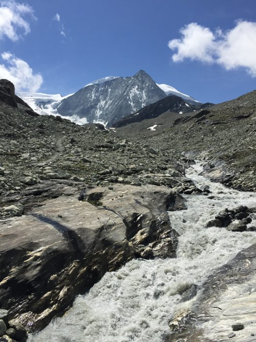 Water flowing from the Glacier. Mont Blanc de Cheilon in the background